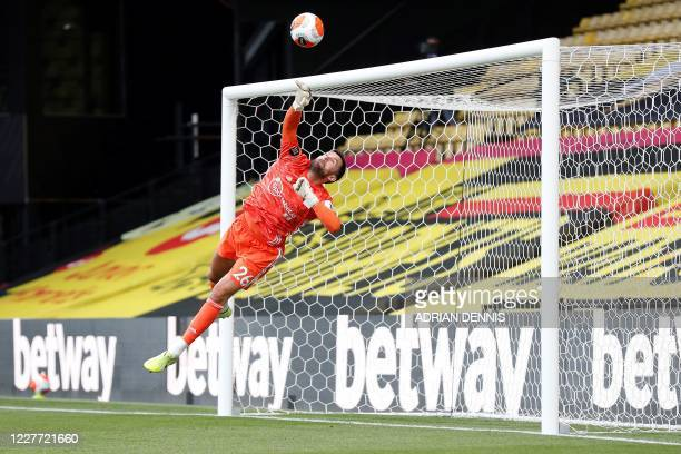 Watford's English goalkeeper Ben Foster saves a shot from Manchester City's Spanish midfielder Rodri during the English Premier League football match...