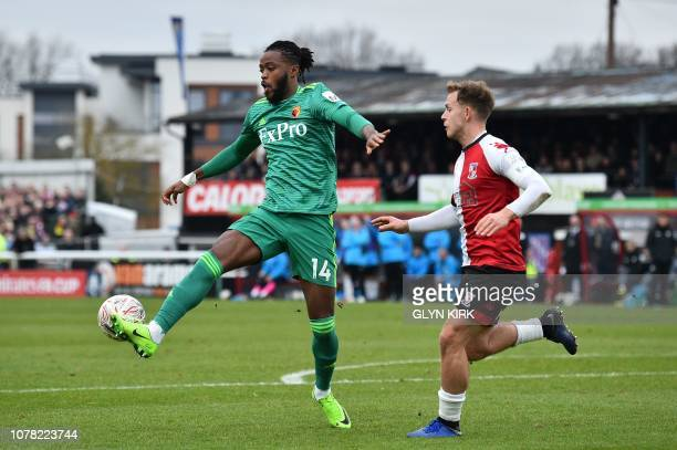 Watford's English midfielder Nathaniel Chalobah controls the ball under pressure from Woking's English defender Josh Casey during the English FA Cup...