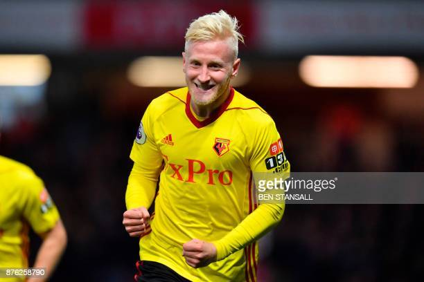 Watford's English midfielder Will Hughes celebrates scoring the opening goal during the English Premier League football match between Watford and...