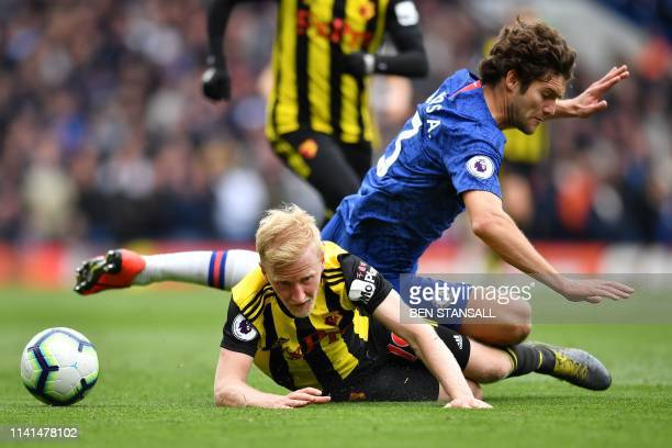 Watford's English midfielder Will Hughes clashes with Chelsea's Spanish defender Marcos Alonso during the English Premier League football match...