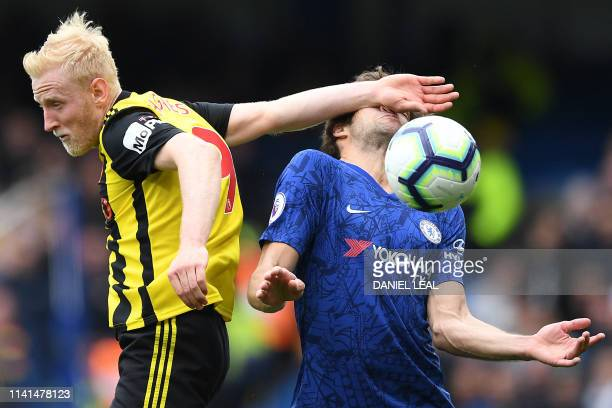 TOPSHOT Watford's English midfielder Will Hughes clashes with Chelsea's Spanish defender Marcos Alonso during the English Premier League football...