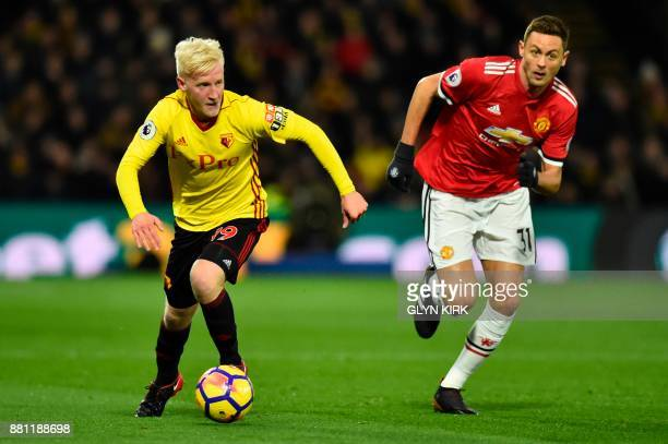 Watford's English midfielder Will Hughes runs with the ball chased by Manchester United's Serbian midfielder Nemanja Matic during the English Premier...