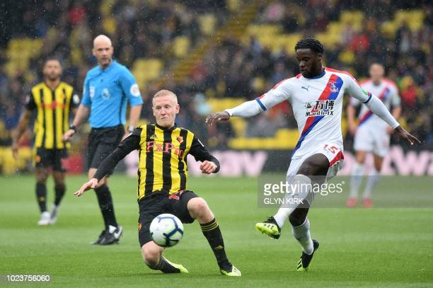 Watford's English midfielder Will Hughes vies with Crystal Palace's German midfielder Jeffrey Schlupp during the English Premier League football...