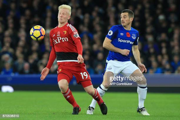 Watford's English midfielder Will Hughes vies with Everton's English defender Leighton Baines during the English Premier League football match...