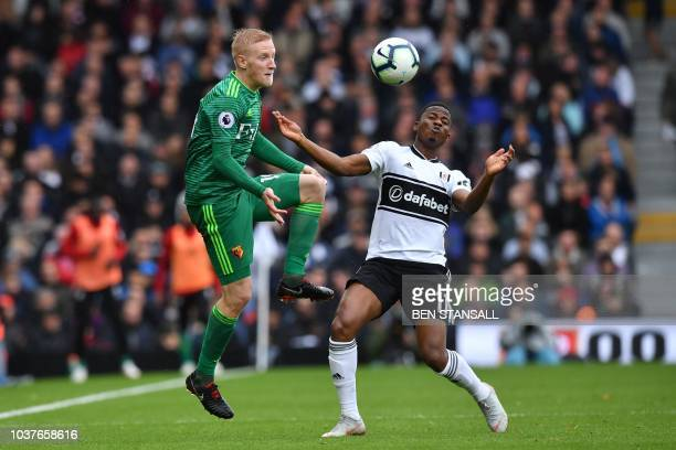 Watford's English midfielder Will Hughes vies with Fulham's Togolese striker Floyd Ayite during the English Premier League football match between...