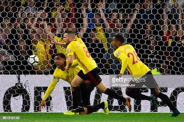 Watford's English mifielder Tom Cleverley celebrates after scoring a late winning goal during the English Premier League football match between...