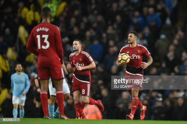 Watford's English striker Andre Gray celebrates after scoring during the English Premier League football match between Manchester City and Watford at...