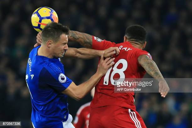 Watford's English striker Andre Gray vies with Everton's English defender Phil Jagielka during the English Premier League football match between...