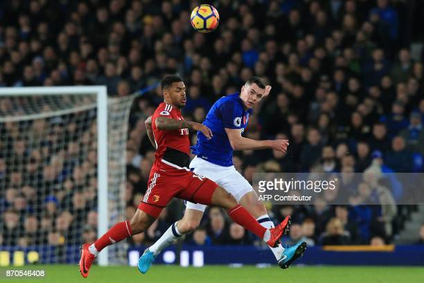 Watford's English striker Andre Gray vies with Everton's English defender Michael Keane during the English Premier League football match between...