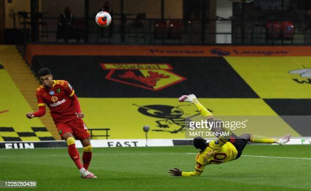 Watford's English striker Danny Welbeck hits an overhead kick and scores his team's second goal during the English Premier League football match...