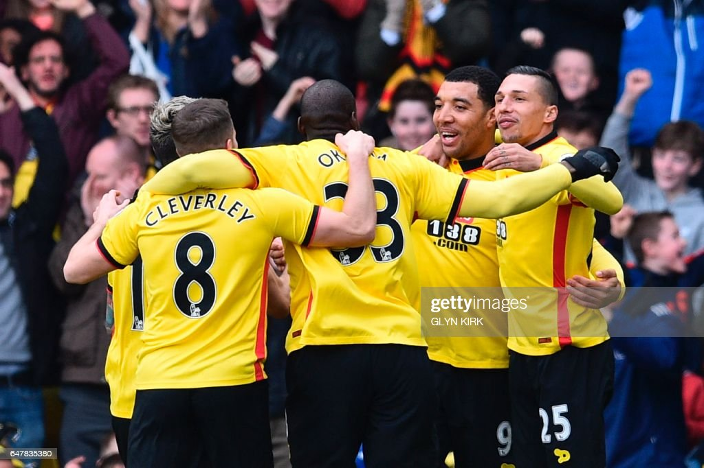 Watford's English striker Troy Deeney (2R) celebrates scoring the opening goal during the English Premier League football match between Watford and Southampton at Vicarage Road Stadium in Watford, north of London on March 4, 2017. / AFP PHOTO / Glyn KIRK / RESTRICTED TO EDITORIAL USE. No use with unauthorized audio, video, data, fixture lists, club/league logos or 'live' services. Online in-match use limited to 75 images, no video emulation. No use in betting, games or single club/league/player publications. /