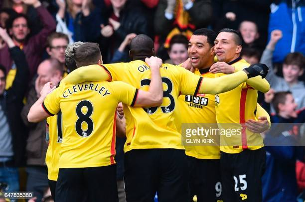 Watford's English striker Troy Deeney celebrates scoring the opening goal during the English Premier League football match between Watford and...