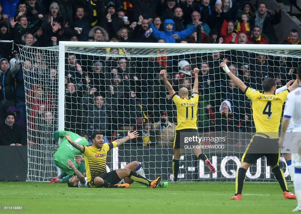 Watford's English striker Troy Deeney (L) celebrates the goal scored by Watford's Spanish midfielder Mario Suarez (R) during the FA cup fifth round football match between Watford and Leeds United at Vicarage Road in north London on February 20, 2016. / AFP / OLLY GREENWOOD / RESTRICTED TO EDITORIAL USE. No use with unauthorized audio, video, data, fixture lists, club/league logos or 'live' services. Online in-match use limited to 75 images, no video emulation. No use in betting, games or single club/league/player publications. /