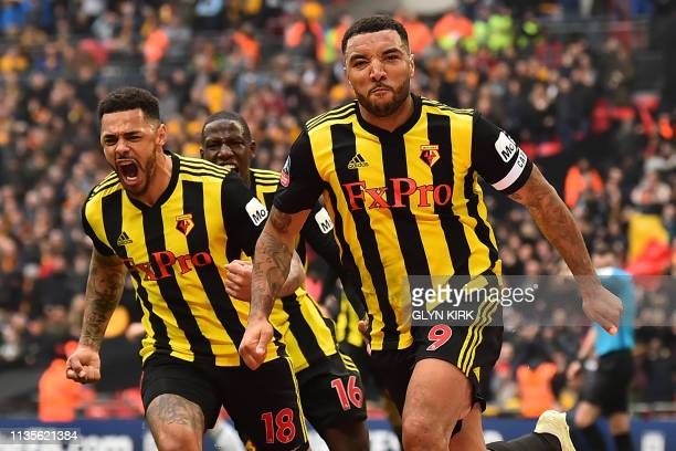 TOPSHOT Watford's English striker Troy Deeney celebrates with Watford's English striker Andre Gray after scoring their late second goal from the...