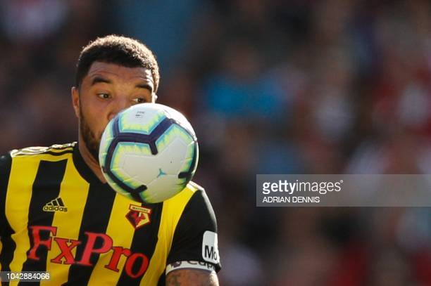 Watford's English striker Troy Deeney controls the ball during the English Premier League football match between Arsenal and Watford at the Emirates...