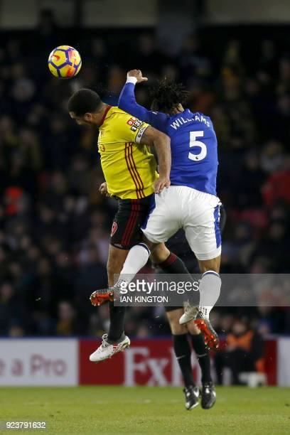 Watford's English striker Troy Deeney vies with Everton's Englishborn Welsh defender Ashley Williams during the English Premier League football match...