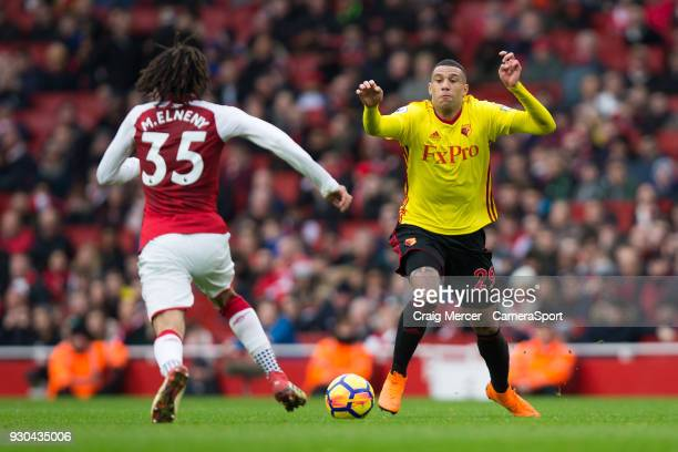 Watford's Etienne Capoue vies for possession with Arsenal's Mohamed Elneny during the Premier League match between Arsenal and Watford at Emirates...