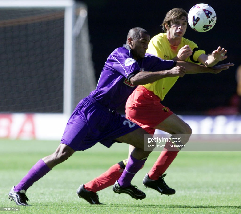 USE. Watford's Filippo Galli battles against Walsall's Harry Erivelto for the ball during the Nationwide Division One game at Vicarage Road, Watford.