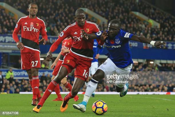 Watford's French midfielder Abdoulaye Doucoure vies with Everton's Senegalese striker Oumar Niasse during the English Premier League football match...