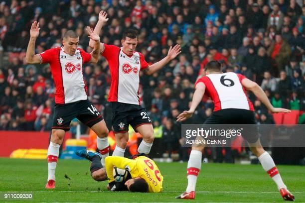 Watford's French midfielder Etienne Capoue goes down as Southampton's Spanish midfielder Oriol Romeu Southampton's Danish midfielder PierreEmile...