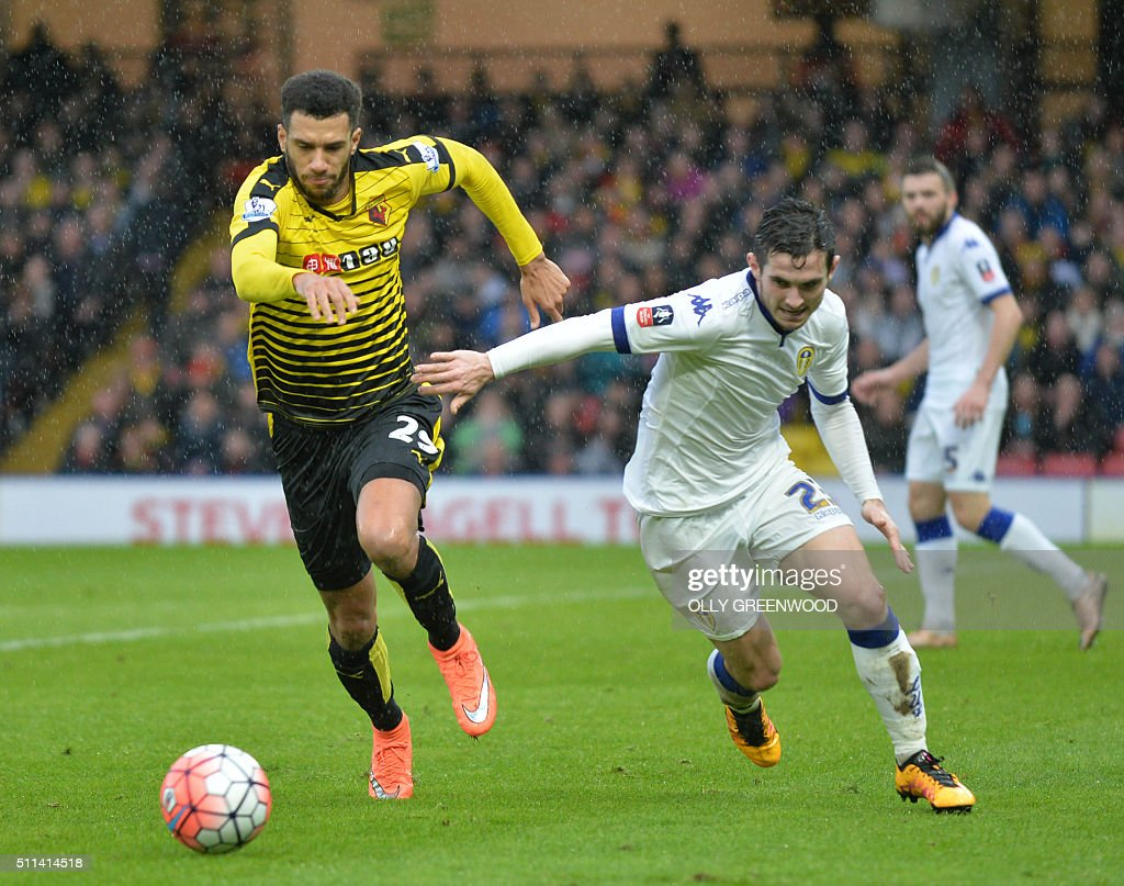 Watford's French midfielder Etienne Capoue (L) vies with Leeds United's English midfielder Lewis Cook (R) during the FA cup fifth round football match between Watford and Leeds United at Vicarage Road in north London on February 20, 2016. / AFP / OLLY GREENWOOD / RESTRICTED TO EDITORIAL USE. No use with unauthorized audio, video, data, fixture lists, club/league logos or 'live' services. Online in-match use limited to 75 images, no video emulation. No use in betting, games or single club/league/player publications. /