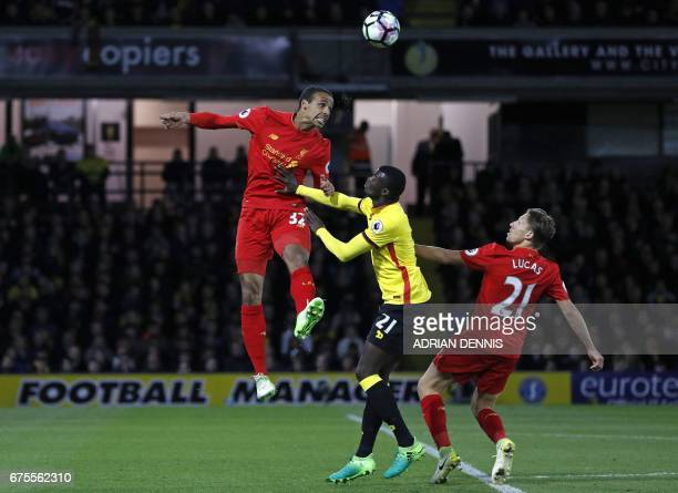 Watford's French striker M'Baye Niang vies with Liverpool's Germanborn Cameroonian defender Joel Matip and Liverpool's Brazilian midfielder Lucas...