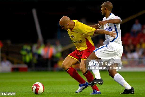 Watford's Gavin Mahon holds off Inter Milan's Olivier Dacourt from the ball during the friendly match at Vicarage Road Watford