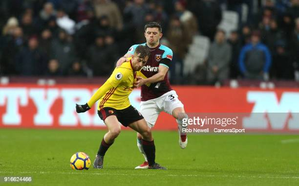 Watford's Gerard Deulofeu and West Ham United's Aaron Cresswell during the Premier League match between West Ham United and Watford at London Stadium...