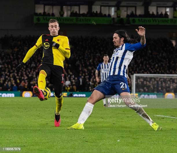 Watford's Gerard Deulofeu battles with Brighton Hove Albion's Matias Ezequiel Schelotto during the Premier League match between Brighton Hove Albion...