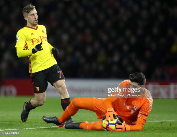 Watford's Gerard Deulofeu has a shot on goal saved by Chelsea goalkeeper Thibaut Courtois during the Premier League match at Vicarage Road Watford