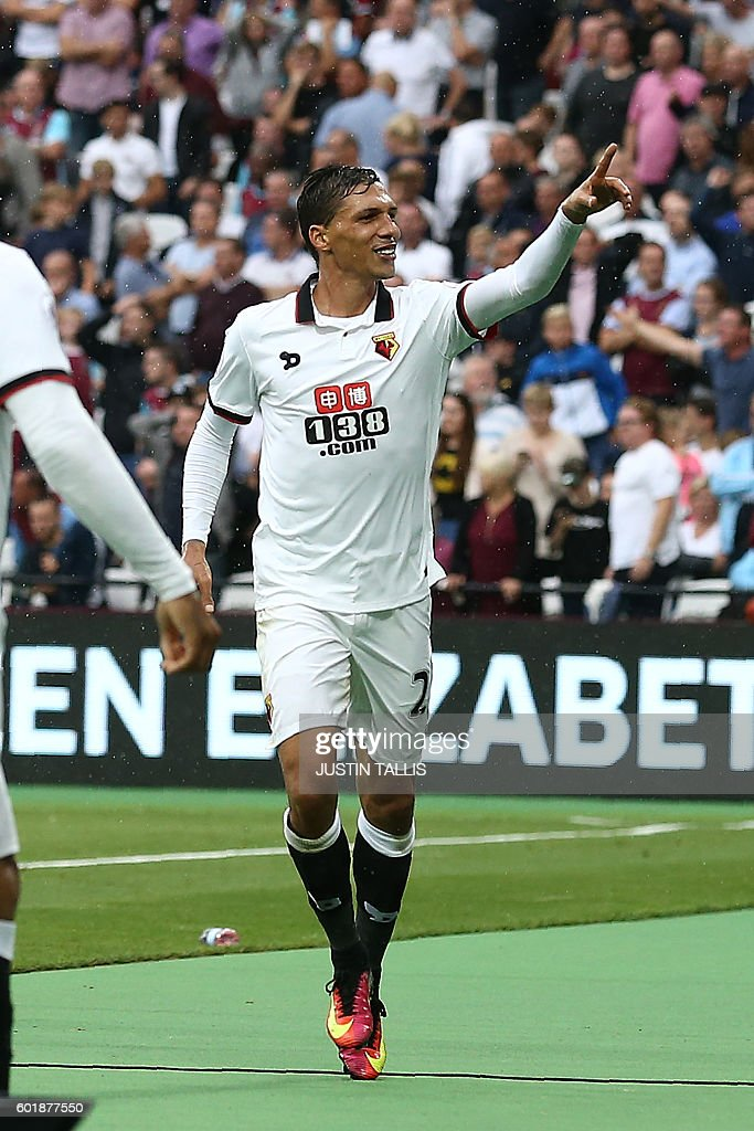 Watford's German-born Greek midfielder José Holebas celebrates scoring his team's fourth goal during the English Premier League football match between West Ham United and Watford at The London Stadium, in east London on September 10, 2016. / AFP / JUSTIN TALLIS / RESTRICTED TO EDITORIAL USE. No use with unauthorized audio, video, data, fixture lists, club/league logos or 'live' services. Online in-match use limited to 75 images, no video emulation. No use in betting, games or single club/league/player publications. /