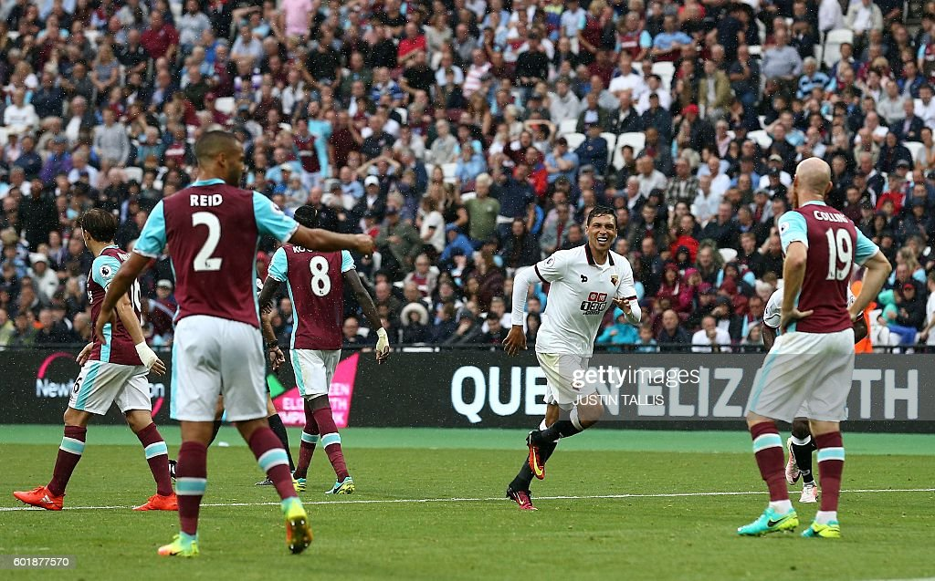 Watford's German-born Greek midfielder José Holebas (2R) celebrates scoring his team's fourth goal during the English Premier League football match between West Ham United and Watford at The London Stadium, in east London on September 10, 2016. / AFP / JUSTIN TALLIS / RESTRICTED TO EDITORIAL USE. No use with unauthorized audio, video, data, fixture lists, club/league logos or 'live' services. Online in-match use limited to 75 images, no video emulation. No use in betting, games or single club/league/player publications. /
