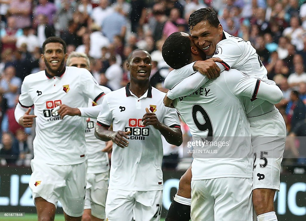 Watford's German-born Greek midfielder José Holebas (R) celebrates scoring his team's fourth goal during the English Premier League football match between West Ham United and Watford at The London Stadium, in east London on September 10, 2016. / AFP / JUSTIN TALLIS / RESTRICTED TO EDITORIAL USE. No use with unauthorized audio, video, data, fixture lists, club/league logos or 'live' services. Online in-match use limited to 75 images, no video emulation. No use in betting, games or single club/league/player publications. /