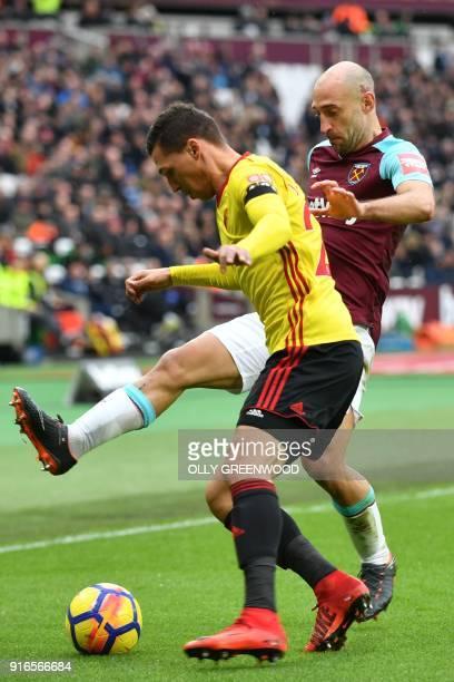 Watford's Germanborn Greek midfielder José Holebas vies with West Ham United's Argentinian defender Pablo Zabaleta during the English Premier League...
