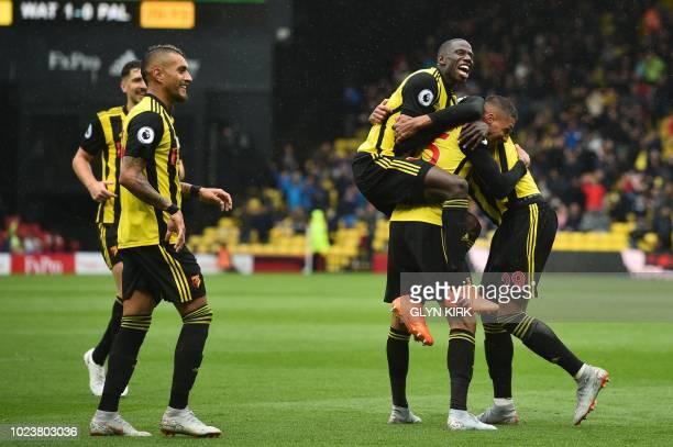 Watford's Germanborn Greek midfielder Jose Holebas celebrates with teammates after scoring the team's second goal during the English Premier League...