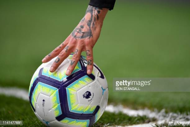 Watford's Germanborn Greek midfielder Jose Holebas places the ball to take a corner during the English Premier League football match between Chelsea...