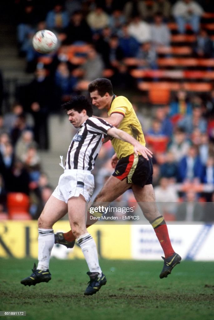 Watford's Glenn Roeder (r) heads clear from Newcastle United's Micky Quinn