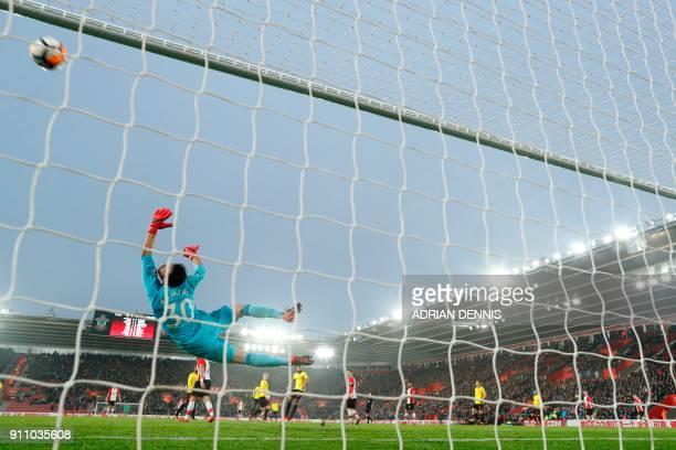 Watford's Greek goalkeeper Orestis Karnezis dives for a shot Southampton's Danish midfielder PierreEmile Hojbjerg that hit the post during the...