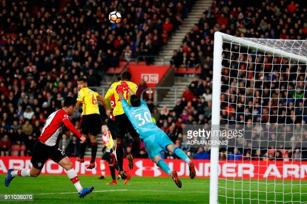 Watford's Greek goalkeeper Orestis Karnezis dives to punch the ball away during the English FA Cup fourth round football match between Southampton...