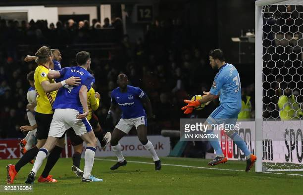 Watford's Greek goalkeeper Orestis Karnezis saves from a closerange header from Everton's Turkish striker Cenk Tosun during the English Premier...