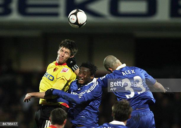 Watford's Grzegorz Rasiak in action against Chelsea's Alex and John Obi Mikel during their FA Cup football match at Vicarage Road in Watford, on...