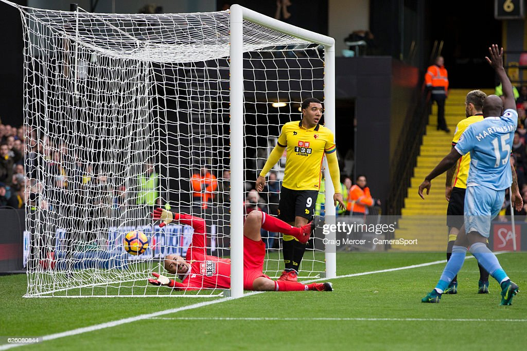 Watford's Heurelho Gomes looks dejected as he watches the ball cross the line for the opening goal during the Premier League match between Watford and Stoke City at Vicarage Road on November 27, 2016 in Watford, England.