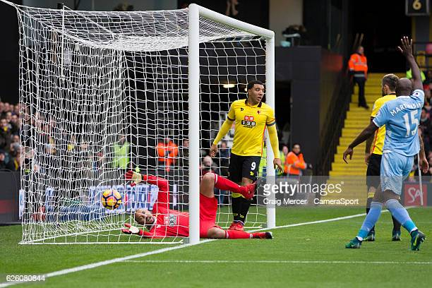 Watford's Heurelho Gomes looks dejected as he watches the ball cross the line for the opening goal during the Premier League match between Watford...