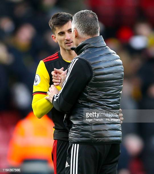 Watford's Ignacio Pussetto and Watford manager Nigel Pearson shake hands after the final whistle of the Premier League match at Vicarage Road London