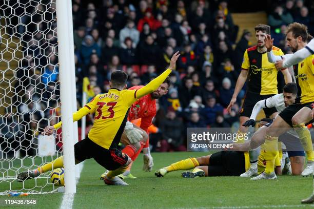 Watfords Ignacio Pussetto clears the ball off the line during the English Premier League football match between Watford and Tottenham Hotspur at...