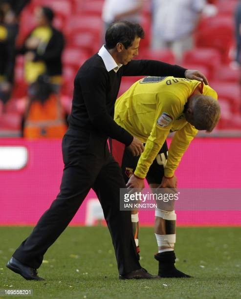 Watford's Italian manager Gianfranco Zola gestures to Watford's Swedish midfielder Joel Ekstrand at the final whistle in the English Championship...