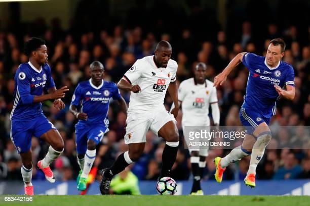 Watford's Italian striker Stefano Okaka runs with the ball against Chelsea's English midfielder Nathaniel Chalobah and Chelsea's English defender...
