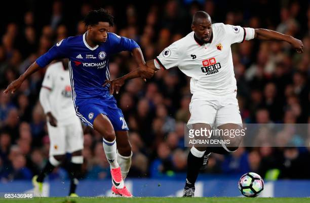 Watford's Italian striker Stefano Okaka tries to hold off Chelsea's English midfielder Nathaniel Chalobah during the English Premier League football...