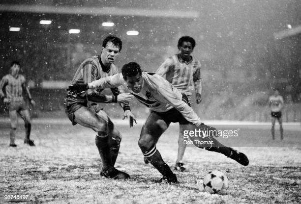 Watford's Jamaicanborn John Barnes wearing gloves to combat the cold weather evades Coventry City defender Trevor Peake during the FA Cup 3rd round...