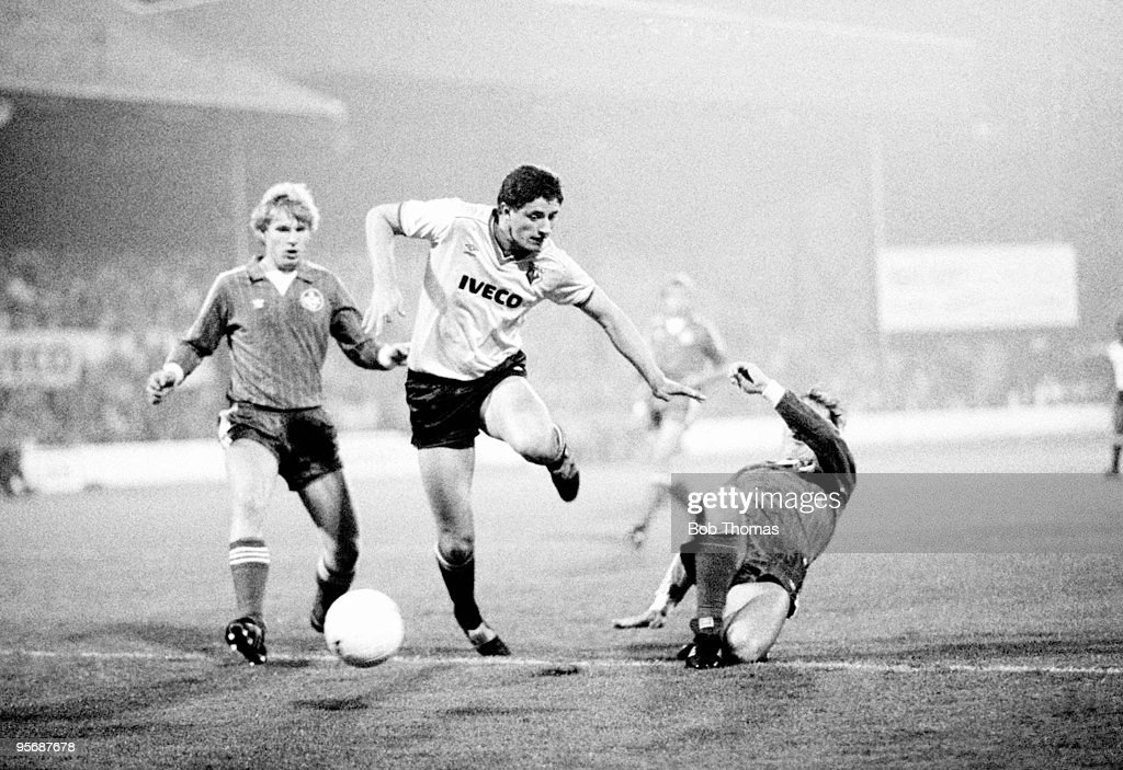 Watford's Jimmy Gilligan (centre) is tackled by Kaiserslautern's Wolfgang Wolf (right) as his teammate Manfred Plat looks on during their UEFA Cup 1st round 2nd leg match held at Vicarage Road in Watford on 28th September 1983. Watford won 4-3 on aggregate. (Bob Thomas/Getty Images).